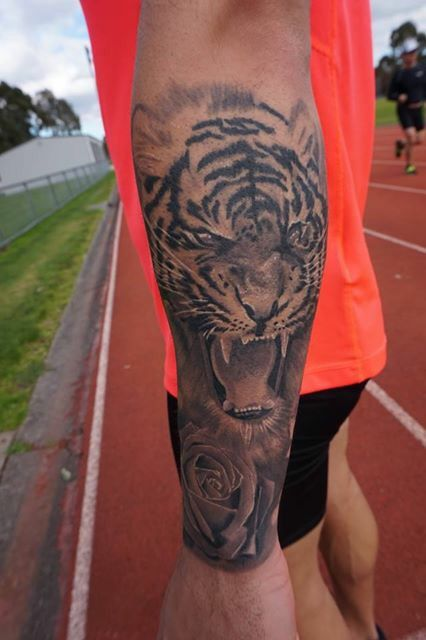Tiger tattoo forearm sleeve ink black and grey realism Chantelle thong lygon street tattoo half sleeve animal tattoo design rose tattoo flower