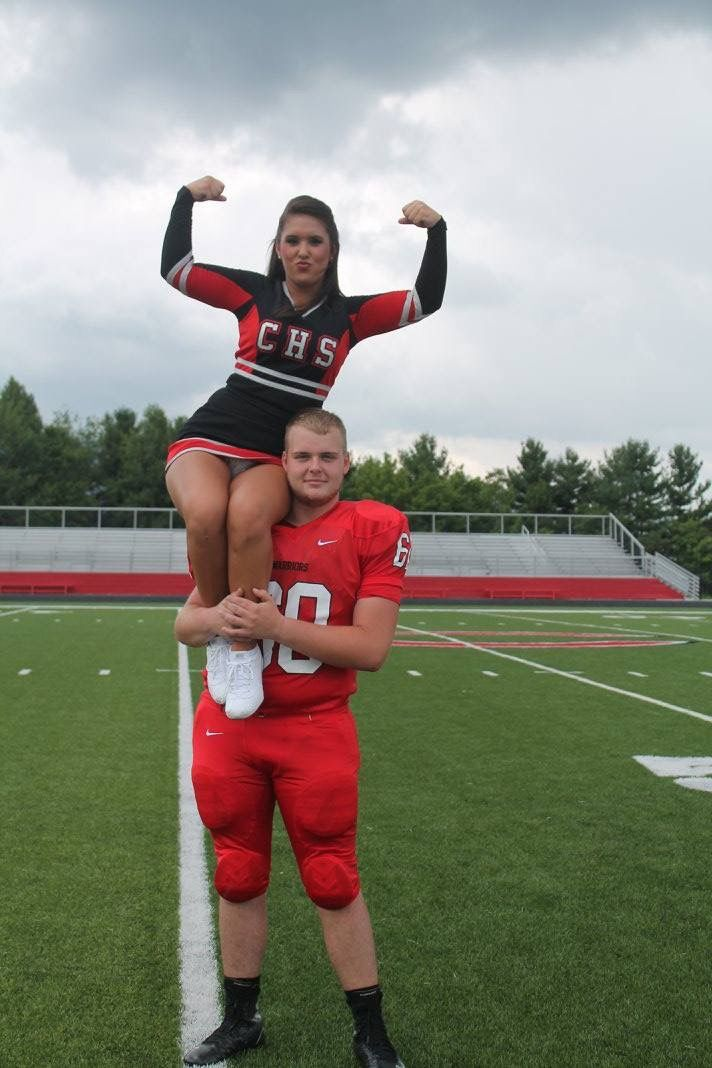 Cheer/football couple pose