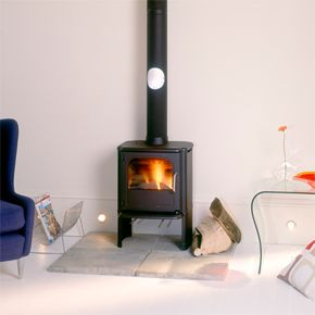 Morso 3440 Convector DEFRA Stove with Plain Sides - Morsø 3440 is a multifuel convection stove that is supplied with ribbed or owl motif sides. Cast iron stove with environmentally friendly heating Morsø 3440 is a well-equipped cast-iron wood-burning stove featuring a sophisticated combustion system with tertiary air supply for optimum control of the combustion process.