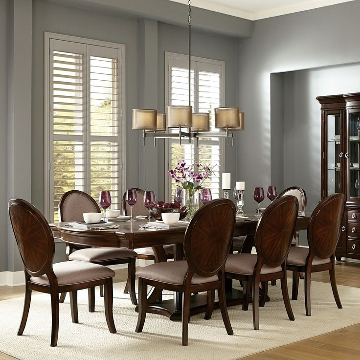 Complete your dining space with this striking Verdiana Rich Brown Cherry Finish Extending Dining Set. The ample sized table top provides you with enough space to comfortably entertain guests and family for years of long lasting use.