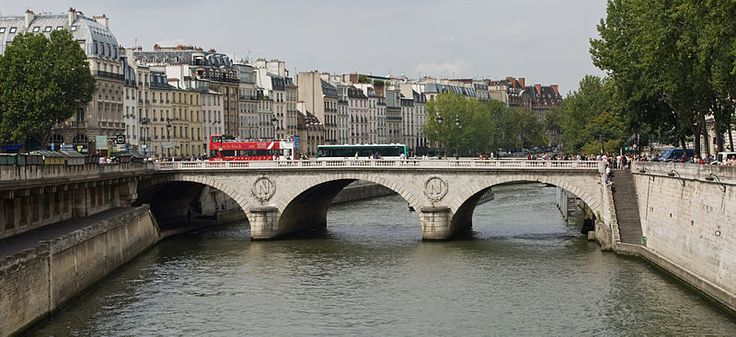 The upstream, east elevation of Pont Saint-Michel, from Petit-Pont. Maigret's Dead Man (2016) can be seen running away from his assailants across this bridge.
