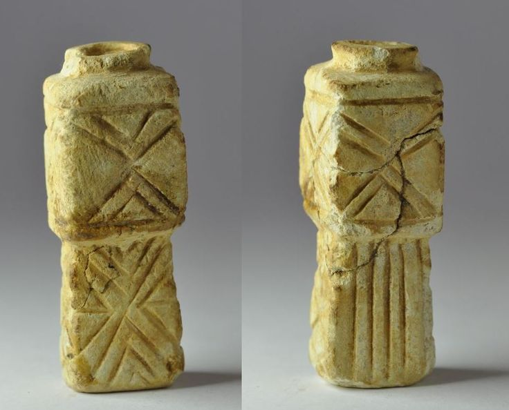 Roman cosmetic limestone kohl tube from Holy Land, Herodian period, 1st century B.C.-1st century A.D. Decorated in geometric style, 6.2 cm high. Private collection