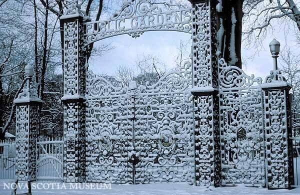 Snowy gates into Halifax Public Gardens.
