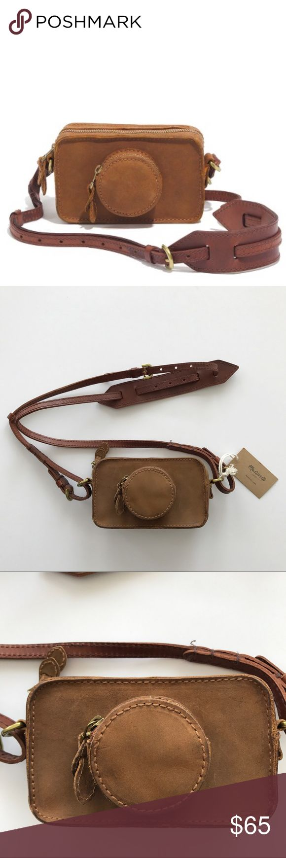 """NWT Madewell Camera Clutch A playful nod to vintage camera bags. Removable strap can clip onto an actual camera. Durable new matte-finish leather develops a rich patina the more you wear it. Leather Zip closure Zip pocket 19 3/4"""" handle drop 5 1/2""""H x 3 1/4""""W x 2""""D Item 08434 Note: both compartments are not attached so can't actually fit a camera with lens. Has partial tag attached – never used! Bag is SMALL – please read measurements. Matte leather has some natural markings on it – not…"""