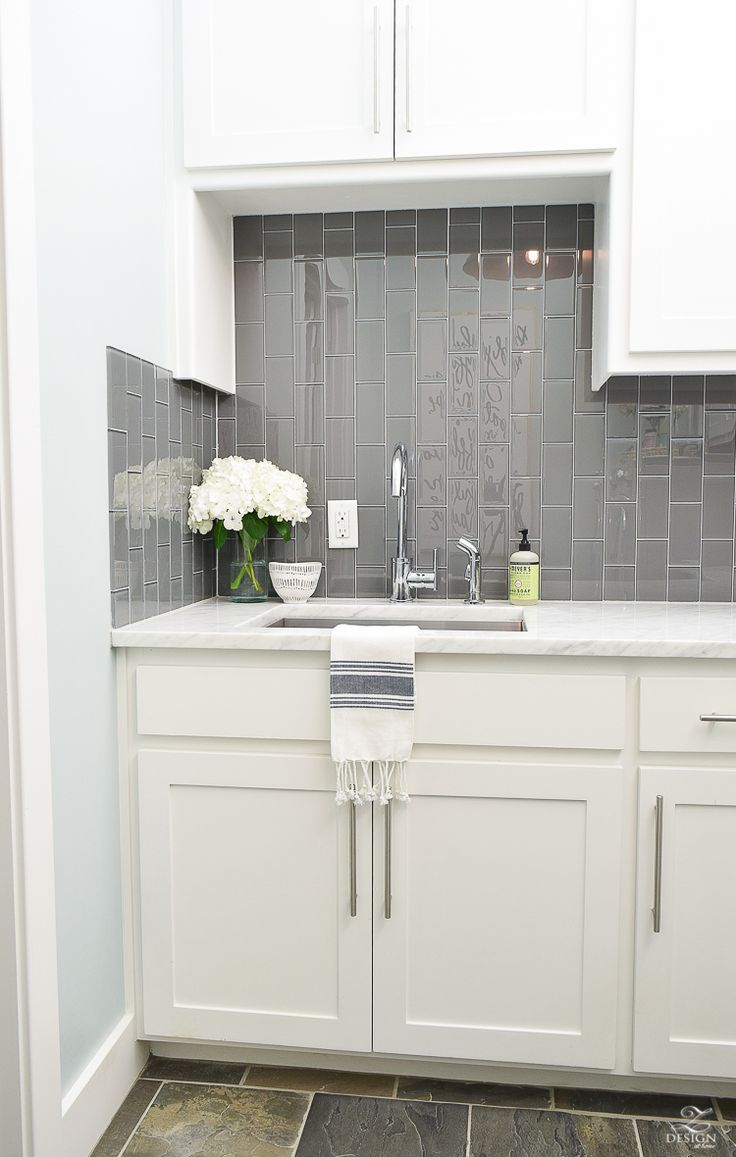Beautiful laundry room ideas danze kitchen faucet stainless laundry room sink gray subway tile installed vertically white shaker cabinets large stainless bar pulls