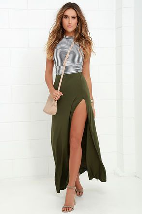 With a salsa step and the Maracas and Cabasas Olive Green Maxi Skirt on your hips, no one will be able to resist you! Soft jersey knit begins at an elastic waistband and ends at a maxi-length, accented with a high and sexy side slit!