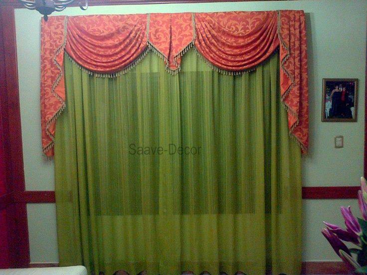 cortina elaborada en color naranja drapeada en tela solida y combinada con un velo de color