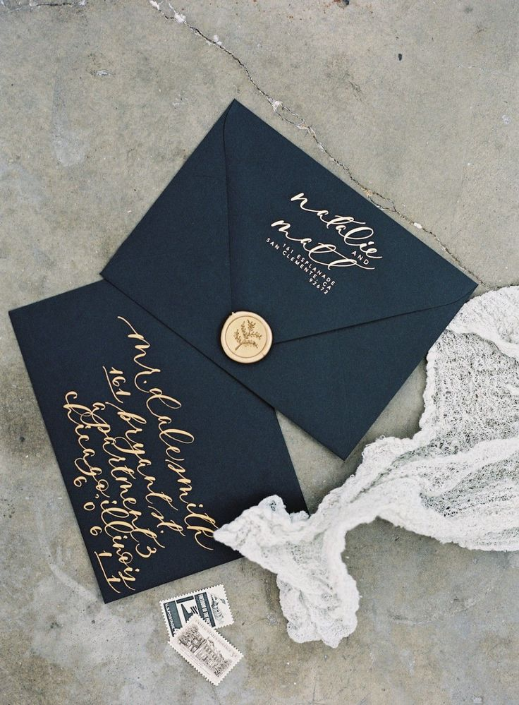 Wedding invitation envelopes in black and gold #wedding