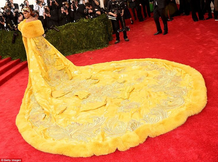 Princess Of China! Rihanna steals the show (and takes up most of the red carpet) wearing a HUGE bright yellow gown for Chinese-themed Met Gala on Monday night in New York