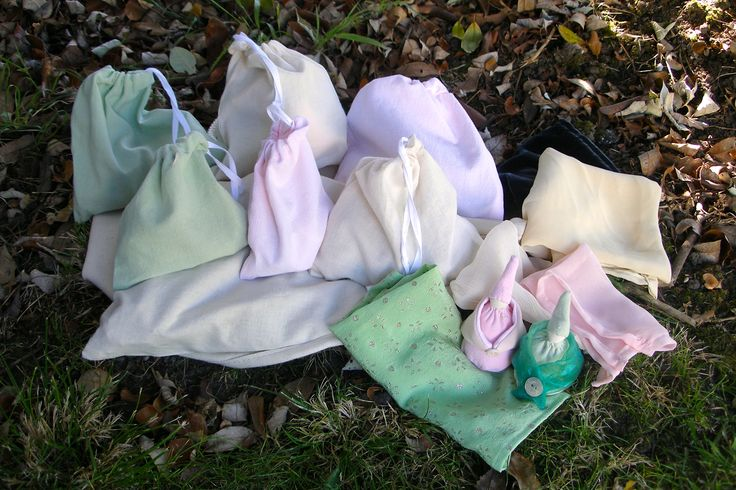 Tiny dolls, textured fabric + calico drawstring bags holding small collections of natural resources, buttons, wooden cotton reels etc.