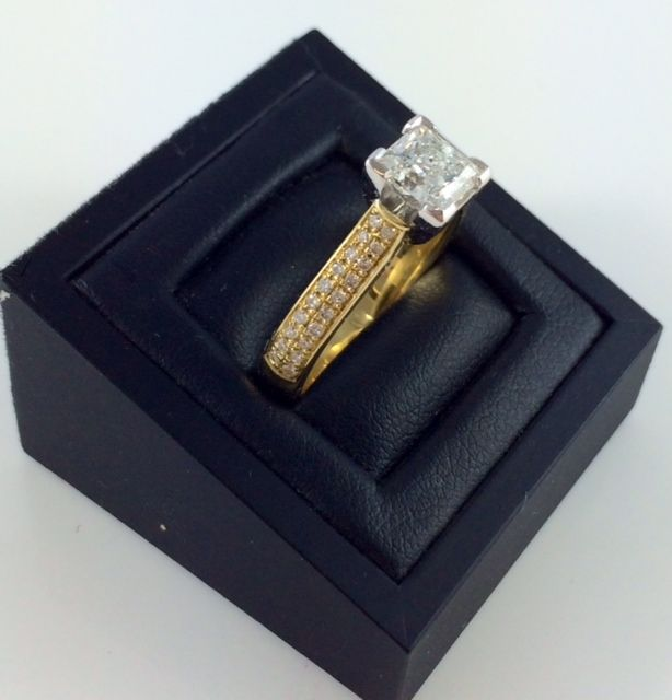 Proud to present one of Phenix Jewellerys Hand Made rings - Available now in the showroom! 18ct Yellow & White Gold Engagement Ring, Raised 4 Claw Set with 1x 0.975ct F SI2 Princess Cut Diamond and 40x G VS Round Brilliant Cut Diamonds Shared Claw Set in 2 Rows on the Shoulders. TDW = 1.165ct  #diamonds #phenixjewellery #gold #engagementring #diamondengagementring