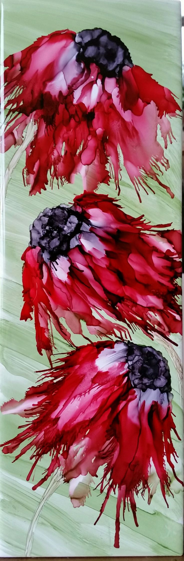 Flowers in alcohol ink on 12x4 tile by Tina.