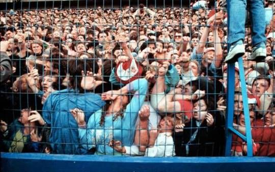 Fans being crushed against a fence in the Liverpool enclosure at the Hillsborough Stadium in Sheffield, England. 96 were killed and 766 injured. 15 April 1989.