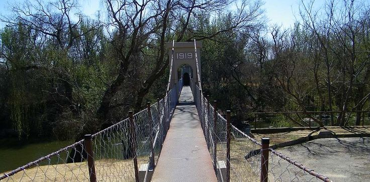 Some of the inhabitants of Parys recognised very early that with the river they had a potential holiday destination. And started projects to enhance this potential. One of the early developments was a pedestrian bridge over the channel to give access to the island. As the inscription says it was built in 1919.