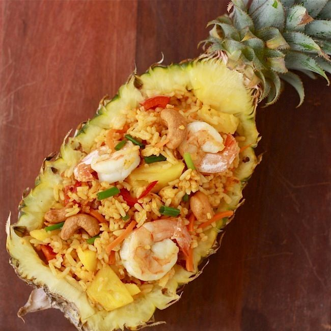 PINEAPPLE SHRIMP FRIED RICE has tips for perfect fried rice: use cold rice; in a wok scoop, stir, and flip rice with a metal spatula until it fluffs up, and press it to bottom of wok for a smoky flavor, continue 'til rice breaks up and is coated with seasoning; use high heat before adding rice, lower heat when it becomes smoky. When rice is broken up and coated, heat back up, stirring well until cooked.