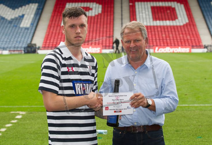 Queen's Park's Adam Cummins picks up his Man of the Match award after the Ladbrokes League One game between Queen's Park and Airdrieonians.