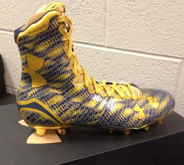 black and gold under armour highlight cleats