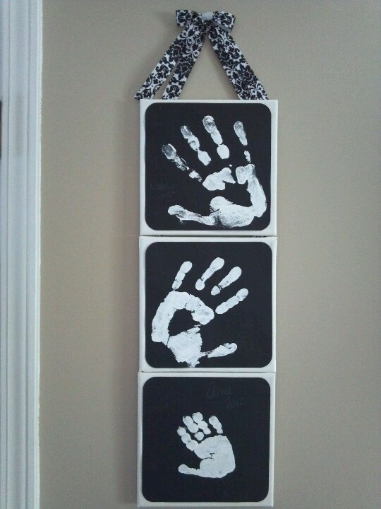 Daddy, mommy, and baby hand prints debating between this idea and another...