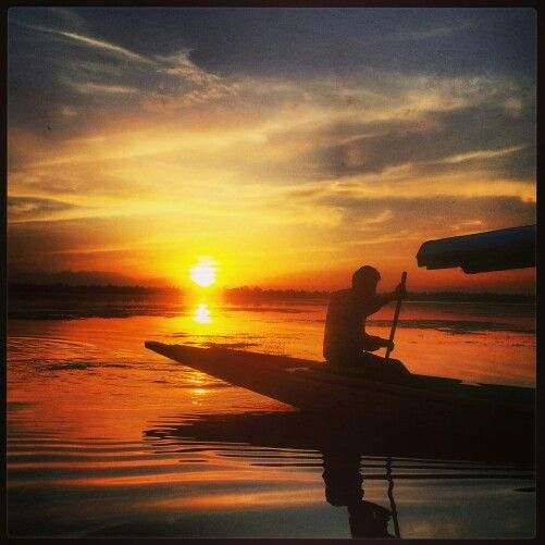 Awesome sunset on the Dal Lake, Srinagar with a Shikara in the foreground