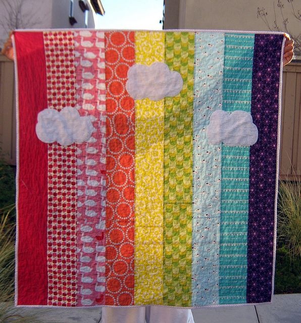 Rainbow quilt -- love the strips of color & the clouds. And I could sew straight lines!