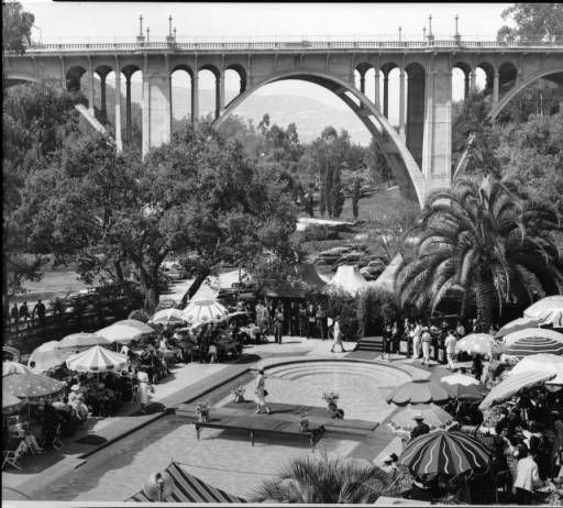 View of the swimming pool at the Hotel Vista del Arroyo in Pasadena, showing the Arroyo Seco bridge, ca.1940-1949 :: California Historical Society Collection, 1860-1960.  With David Ebershoff in The Danish Girl.