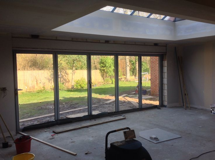 Work in progress... Schuco bi-folds x5 1.1m doors and lantern roof.