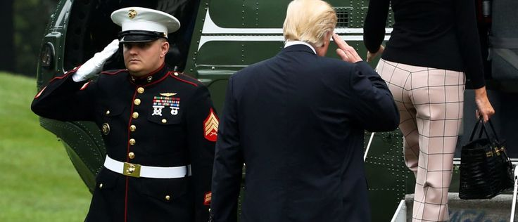 U.S. President Donald Trump (C) returns a U.S. Marine's salute as he and first lady Melania Trump board the Marine One helicopter to depart for travel to Poland and the upcoming G-20 summit in Germany, from the South Lawn of the White House in Washington, U.S., July 5, 2017. REUTERS/Jonathan Ernst - RTX3A4B8
