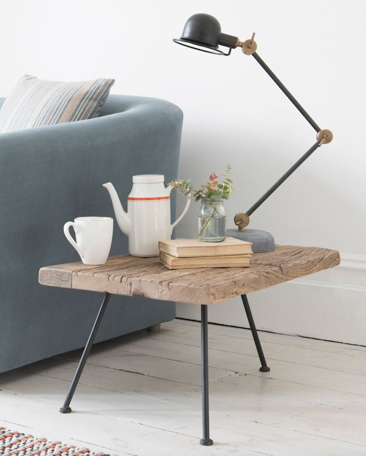 Loaf's textured wooden tripod Gimme side table with industrial metal legs. Perfect for coastal living.
