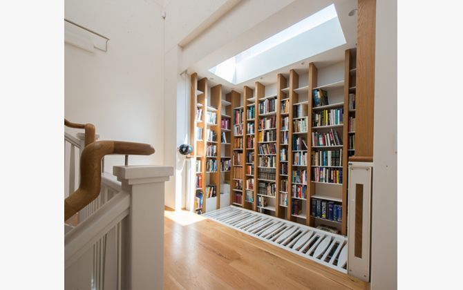 The American Oak irregularly spaced shelving allows the compact storage of differently sized books.   Photography: Justin Alexander