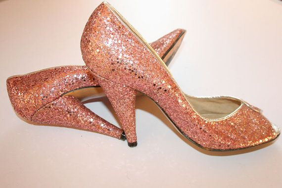 Gorgeous mid 1970s pink glitter shoes by legendary cobbler Terry De Havilland. They are peep toe with classic cone heel.