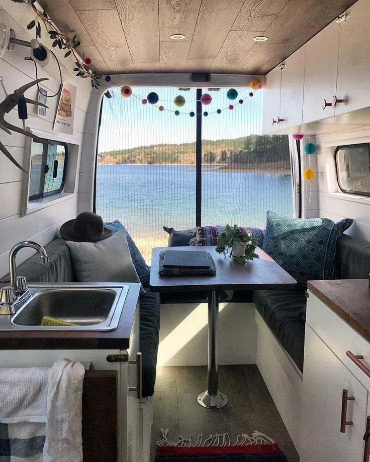 I love this van interior, especially the bug net! It makes the layout of campervan look so much more open. #vanlife goals.