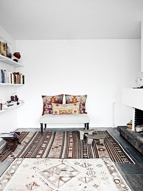This modern, clean lined Danish home is decorated with beautiful ethnic style furniture and accessories. ~ kilim rugs and cushions.  #modern #white