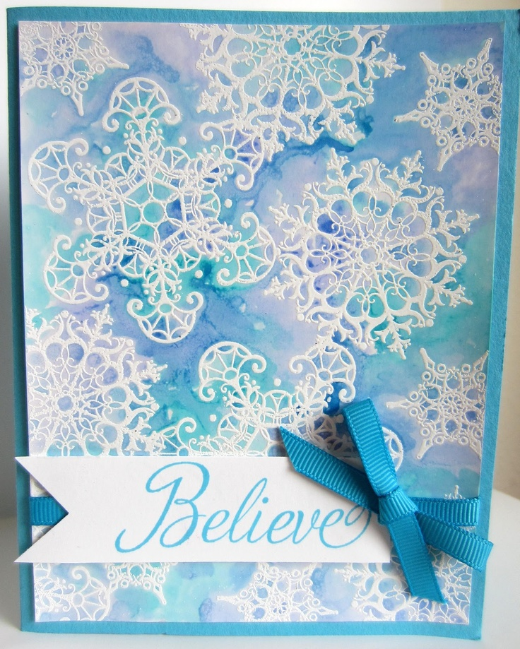 By Linda Kilsdonk. Stamp snowflakes with VersaMark on glossy white cardstock. Emboss in white. Use reinkers to color: Drop one drop each of 3 reinkers on a scrap of glossy cardstock. Spritz embossed piece with water. With an Aqua Painter, pick up a bit of one reinker color and randomly drop it here & there among the snowflakes. Continue doing this with each of the colors until the background is covered with blended ink. Heat set.