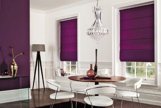 Making a statement, with purple Roman Blinds and a feature wall..