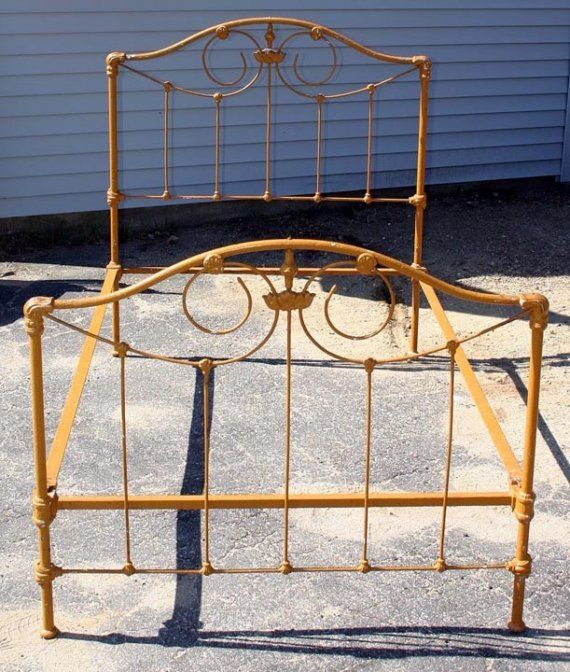 Your heart will skip a beat when you  see this in person.  Antique Cast Iron 3/4 Bed in Mustard Yellow with red underpaint. Complete with chips in the paint to expose the years of use.  $300.00
