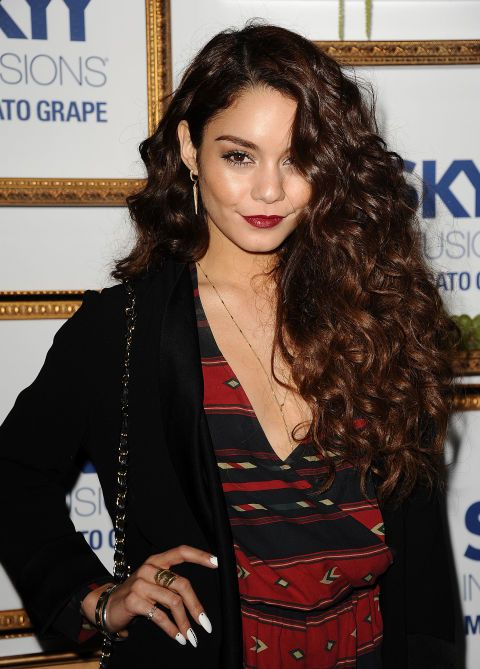 Here, Vanessa accomplishes the highly sought after but hardly executed mysterious-girl sweep. The deep part and high-volume curls make the style sultry and sophisticated.
