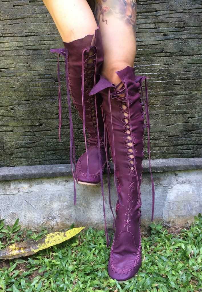 Available for delivery within 3-8 days These beautiful plum knee high leather boots are designed for the pixie at heart. With a unique design to inspire the imagination and evoke the senses :) Feel good in these incredible leather boots for women, made especially by artisans who have your comfort, body and soul in mind. The delicate lacing allows you to fasten them bespoke to you, from top to toe letting your skin breathe naturally. And the flexible soles, make every magical journey a…