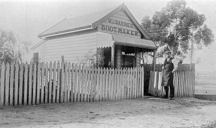 Nhill,Victoria in 1915. A bootmaker at the gate to his shop: 'W. Barnes, Bootmaker'