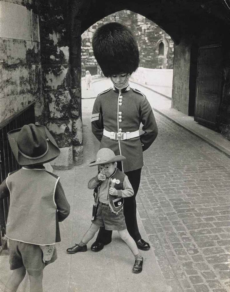 Children playing around a guardsman, London, England, 1963, by Hans Hammarskiöld.