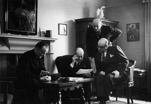 Exiled Czechoslovak leaders meeting at the Putney home of former Czechoslovak president Dr Eduard Beneš (1884 - 1948), London, November 1939. Left to right: Colonel František Moravec, Eduard Beneš, Jaromir Smutny and Foreign Minister Jan Masaryk (1886 - 1948). Original publication: Picture Post 227 - My Country - pub 1939 (Photo by Tim Gidal/Hulton Archive/Getty Images)