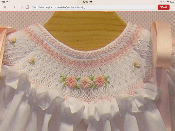 Beautifully made flowers on smocking.