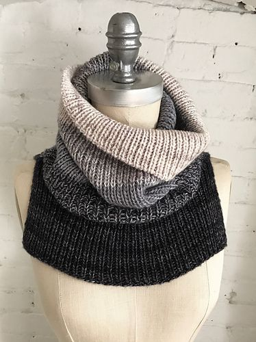 FLYING SOLO is a chic and minimalist unisex ribbed cowl knit with three colours of Artfil Solo.Two strands are held together throughout the project with one strand being changed at a time to create a series of ombre stripes. The cowl is knit from the bottom up with the front and back flap knit separately and then joined to knit in the round.