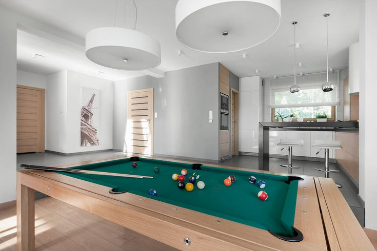 Wooden Dinning Billiard Table and White Lamps near the Small Pantry
