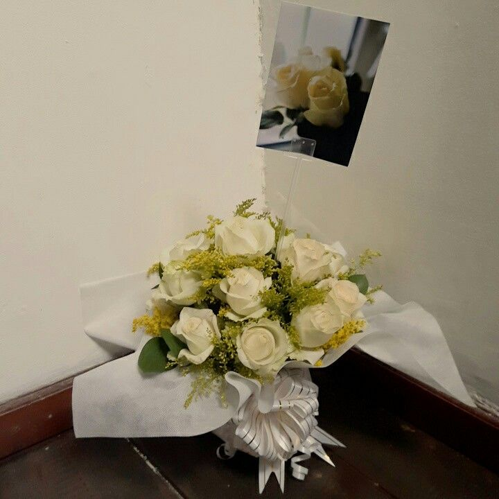 A deep condolences White roses bouquette. Monday ordered by Mrs. Ika.