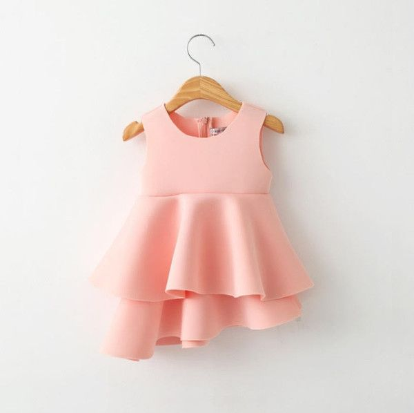This neoprene ruffled pink dress is perfect for any fashionable girl. Available at www.littletrendsetter.com