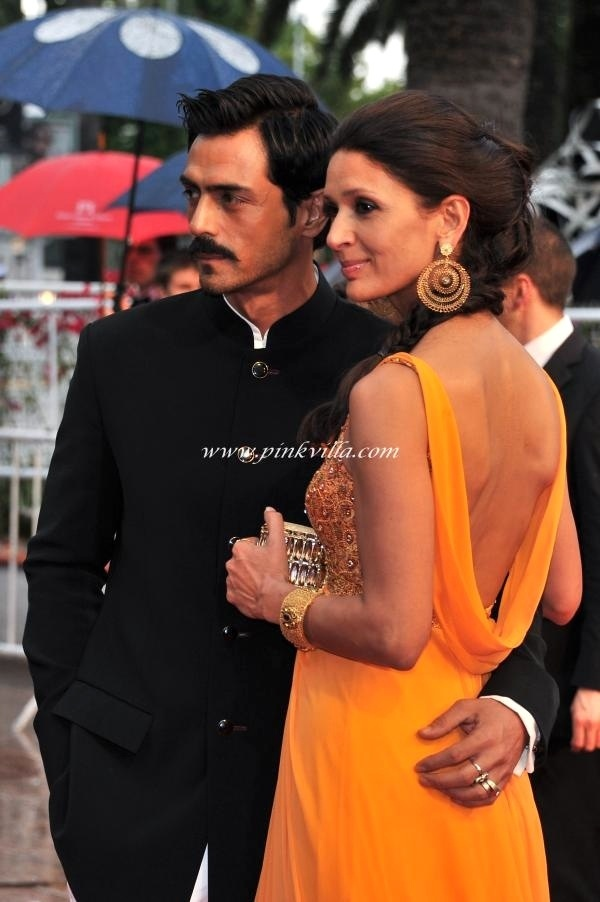 The incredibly sexy Arjun Rampal in Rohit Bal and Mehr in Tarun Tahiliani. We love his look, but hers, not so much. Too orange popsicle for us! They walked the #Cannes2012 Closing Gala red carpet.