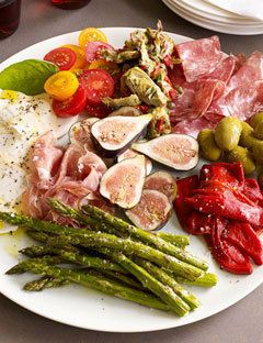 Italian antipasto platter - cheese, italian style veggies, olives, artichoke hearts etc. served family style