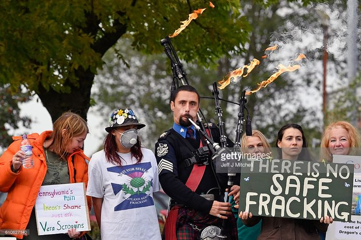 A piper plays as protestors demonstrate, outside INEOS headquarters, as the first ship carrying shale gas from the US arrives in the Firth of Forth en route to Grangemouth Oil refinery on September 27, 2016 in Edinburgh, Scotland. The tanker is the first of eight, shipping ethane from US shale fields, in a two billion dollar investment by chemical company INEOS.