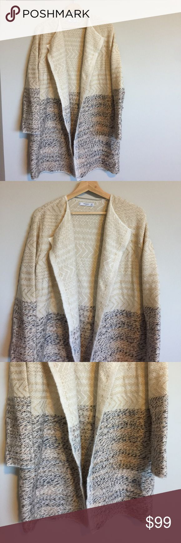 Mango Sweater Duster Mango sweater Duster that I bought in Norway while on vacation. Never worn/ no tags attached. Size Small.              🌵i LOVE offers!                                                                         🌵bundle and save 15% 🌵shipped from a smoke/pet free home                                                                                                     ✖️no trades/ PayPal Mango Sweaters Cardigans