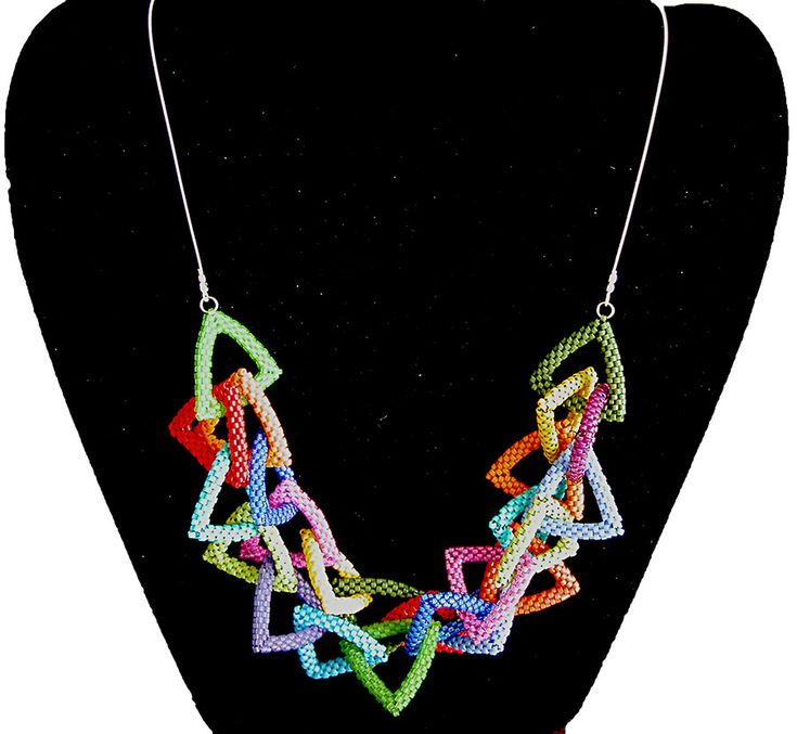 Nita E Kaufman - multicolored and layered triangles attached to 925 softflex silver wire.